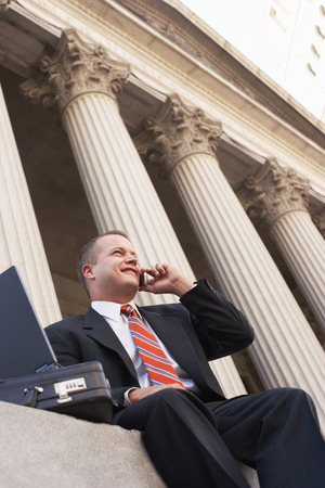 Happy Attorney on Cell Phone Stock Photo - 5494501