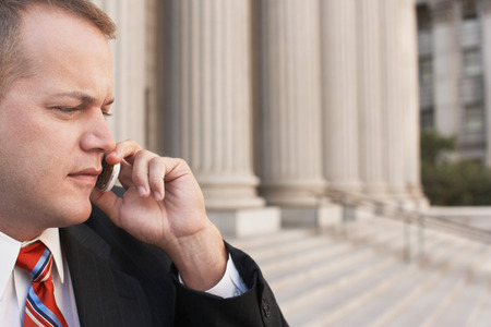 Worried Attorney on Cell Phone Stock Photo - 5494502