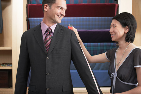 no kw 1: Businessman Being Measured by Seamstress