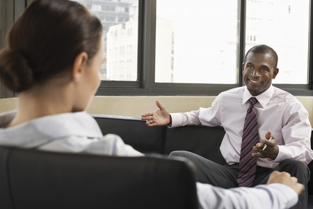 conversational: Two Businesspeople Having a Conversation