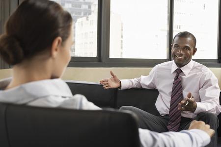 blacks: Two Businesspeople Having a Conversation