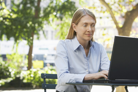 microcomputer: Woman Outdoors Using Laptop