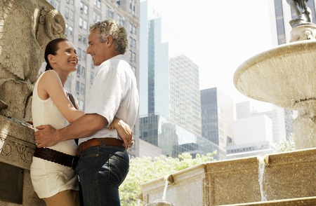 Affectionate Couple by Fountain Stock Photo - 5494535