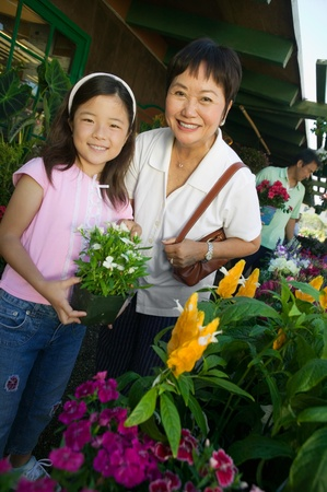 plant nursery: Grandmother and granddaughter in plant nursery portrait
