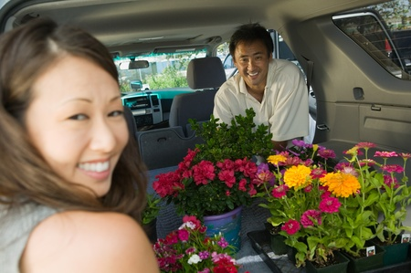 Couple Loading flowers into back of SUV portrait Stock Photo - 8822552