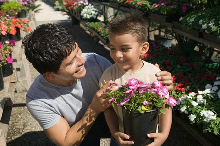 Father and Son Shopping for Plants in plant nursery close up Stock Photo - 8822557