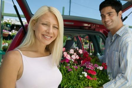 Couple Loading Plants Into Minivan portrait Stock Photo - 8822569