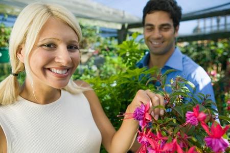 Woman selecting Flowers in plant nursery portrait Stock Photo - 8822575