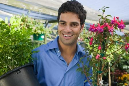 Man Carrying Plants in plant nursery portrait Stock Photo - 8822576