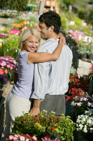 Couple at Plant Nursery hugging Stock Photo - 8822578