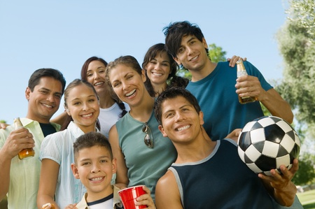 Boy (13-15) with family at park low angle view. Stock Photo - 8822648