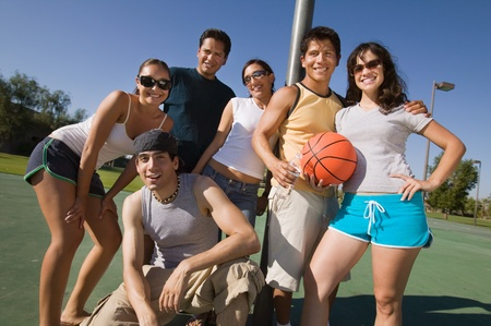 Group of young adults at basketball court. Stock Photo - 8822675