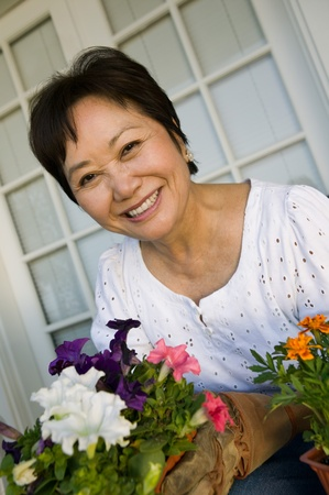 Woman with flowers outdoors (portrait) Stock Photo - 8822703
