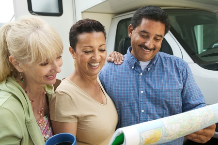 Friends studying road map beside motor home Stock Photo - 8822715