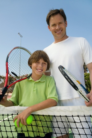 Father and Son at Tennis Net portrait Stock Photo - 8822791