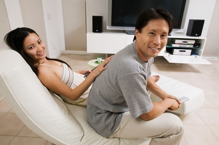 Couple sitting in Living Room Together portrait Stock Photo - 8822834