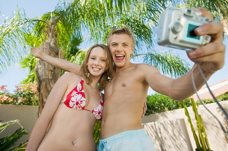 Young couple taking photo of themselves low angle view Stock Photo - 8822869