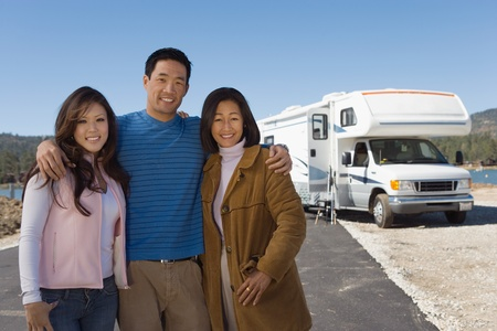 30s adult: Family with teenage daughter outside of RV