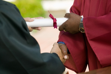 african american handshake: Graduate Receiving Diploma and Handshake mid section