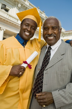 Graduate with father outside university portrait Stock Photo - 8836213