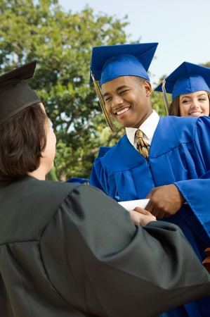 Graduate shaking hand of dean outside low angle view Stock Photo - 8836221