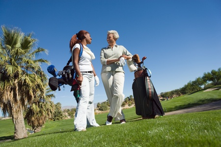 Grandmother and granddaughter on golf course smiling Stock Photo - 8836287
