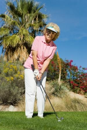 Woman playing golf (portrait) Stock Photo - 8836290