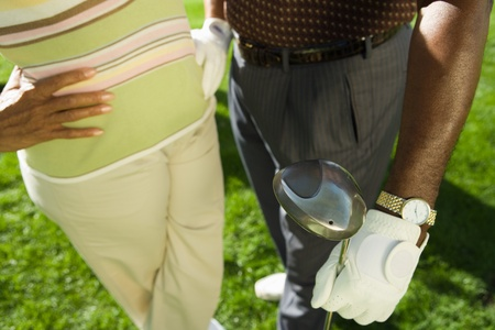 Senior couple in golf course (mid section) (elevated view) Stock Photo - 8836291