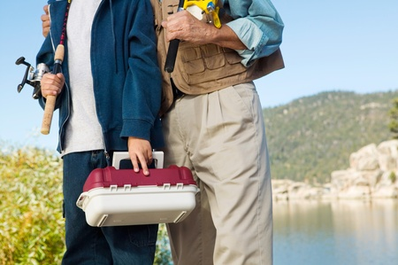 Father and son on fishing trip (mid section) Stock Photo - 8836302