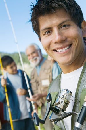 Male members of three generation family on fishing trip focus on mid adult man (portrait) Stock Photo - 8836304