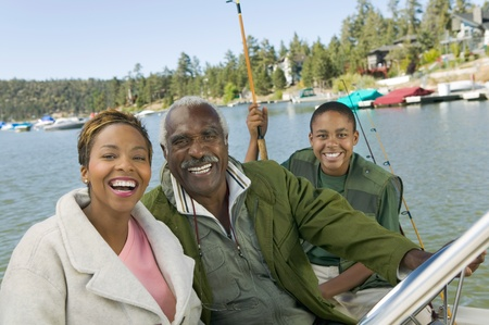 pre adult: Three generation family on fishing trip smiling (portrait)