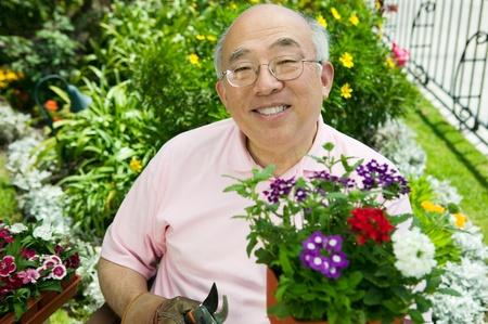 Senior man gardening (portrait)