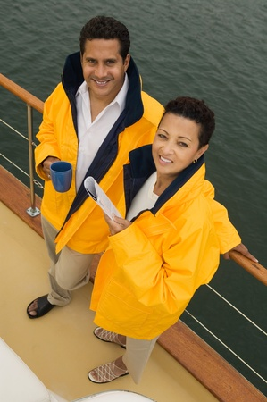 anorak: Couple wearing yellow anoraks on yacht (portrait) (elevated view)