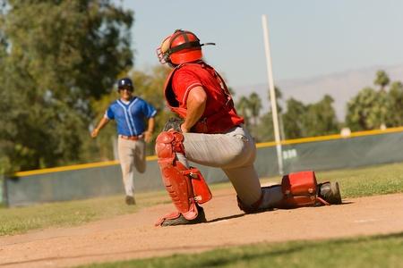 baseball diamond: Runner approaching to catcher