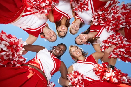 cheerleading squad: Cheerleaders in Huddle view from below (view from below) LANG_EVOIMAGES