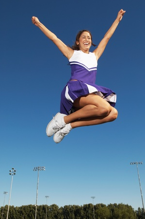 Cheerleader jumping mid air low angle view (low angle view) Stock Photo - 8836460
