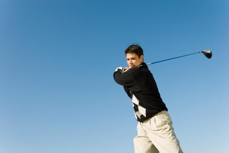 Golfer swinging club Stock Photo - 8836469