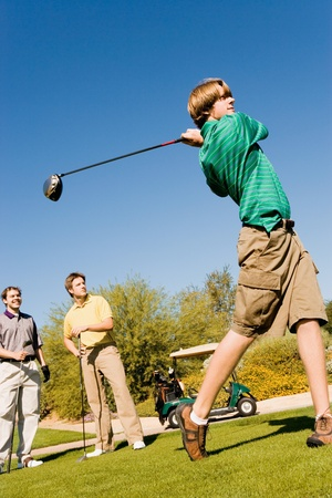 Golfer teeing off Stock Photo - 8836475