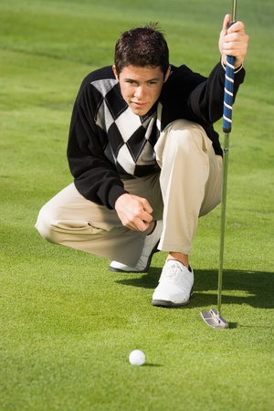Golfer lining up putt Stock Photo - 8836502