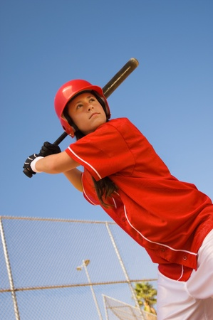 softball player: Softball player at bat portrait low angle view