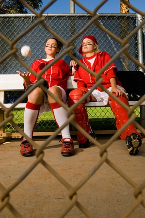 Softball players sitting on bench front view Stock Photo - 8836540