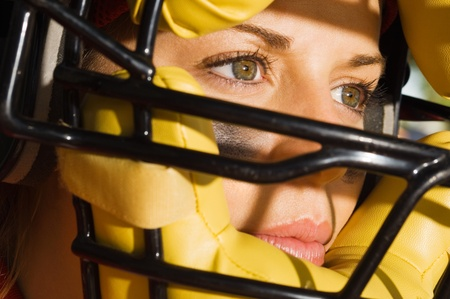 softball player: Softball player wearing helmet close-up of face