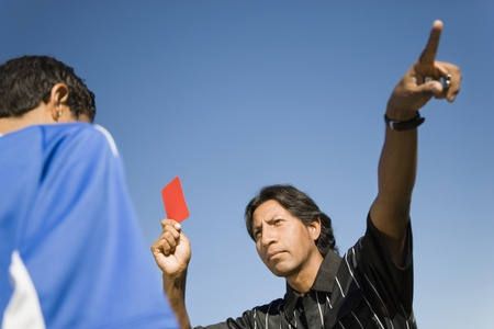 Referee holding up red card and pointing portrait Stock Photo - 8836576