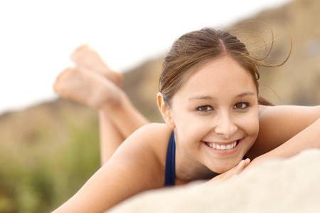 Smiling Woman lying down on Beach portrait Stock Photo - 8837086