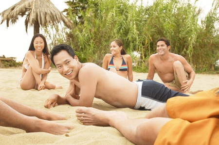 Group of Friends talking on the Beach Stock Photo - 8837091