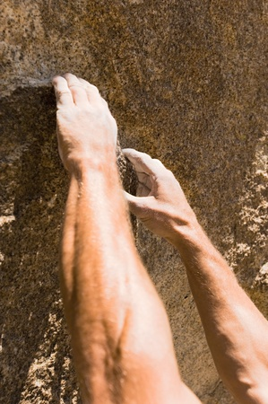 Man climbing on rock close-up on hands Stock Photo - 8837095