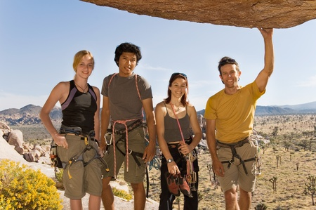 Young Climbers standing Underneath Rock (portrait) Stock Photo - 8837099