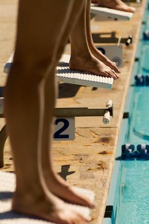 starting blocks: Female swimmers on starting blocks (low section)