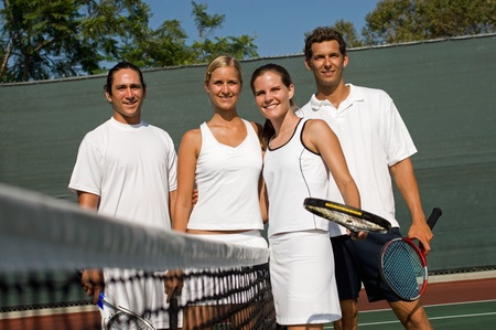 doubles: Mixed Doubles Tennis Players standing at Net arms around LANG_EVOIMAGES