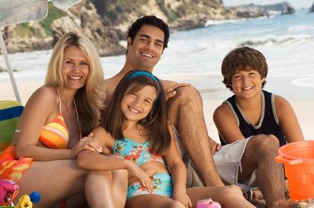 Family in swimwear sitting on beach portrait Stock Photo - 8837199